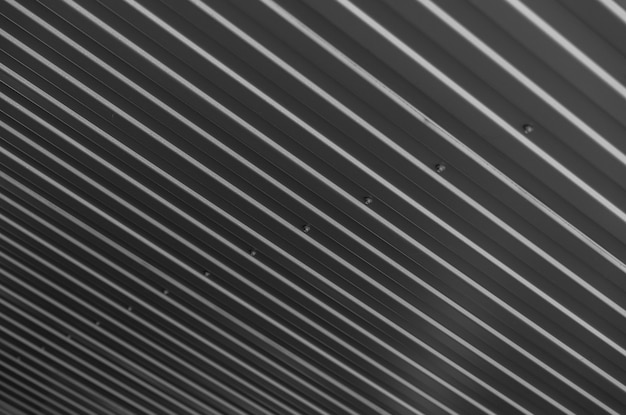 Corrugated dark material on rooftop surface, diagonal
