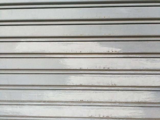 Corrugated metal steel door background and texture surface.