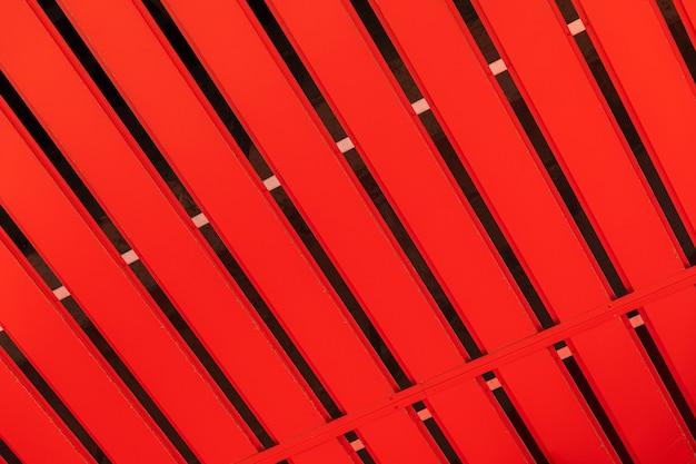 Corrugated orange metal profile surface (corrugated metal siding, profiled sheeting) background.