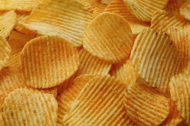 Corrugated potato chips. food  texture background. top view.