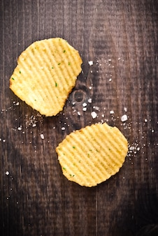 Corrugated potato chips and salt