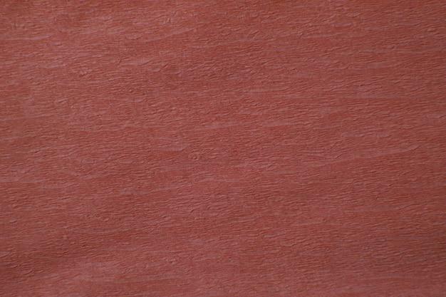 表面の段ボールの赤い紙テクスチャ背景