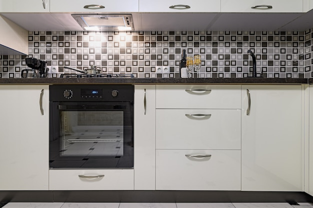 Coseup of minimal simple black and white large modern kitchen interior