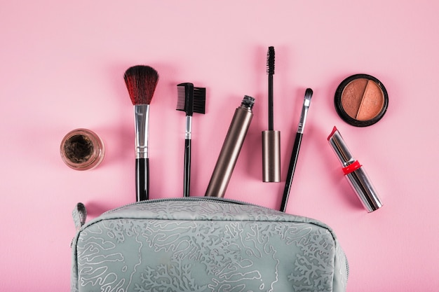 Cosmetic bag containing lipstick; mascara; eyeliner and brushes
