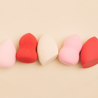 Cosmetic beauty blender sponges top view sponges different shape close up flat lay