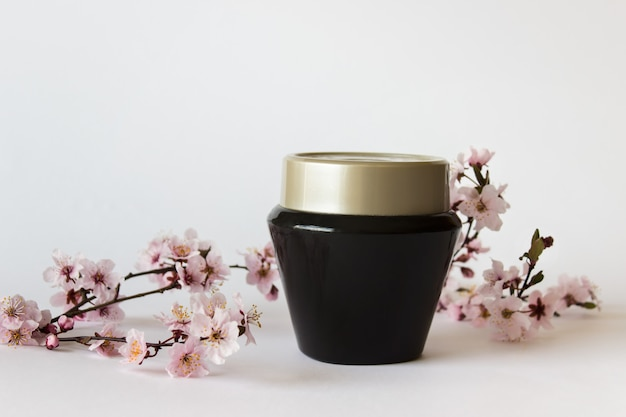 Cosmetic black jar with sakura twig