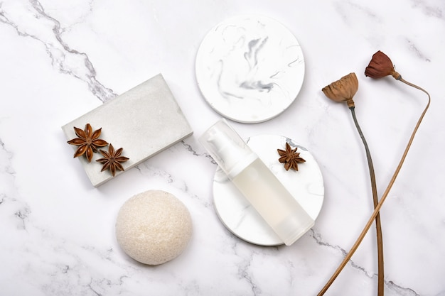 Cosmetic bottle containers on marble background, natural organic beauty product skincare.