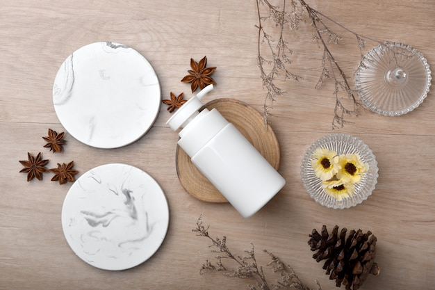 Cosmetic bottle containers packaging with green herbal leaves, blank label for organic branding , natural skincare beauty product concept.