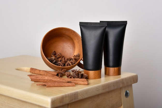 Cosmetic bottle containers with cinnamon.
