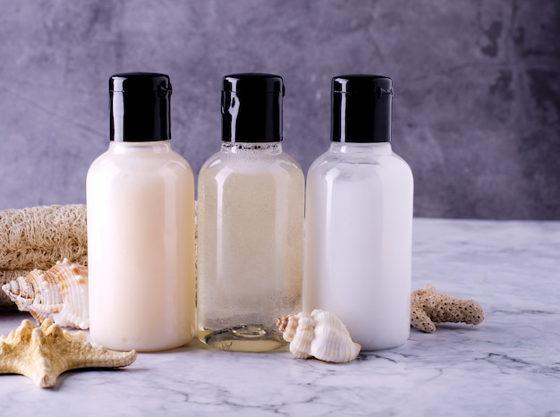 Cosmetic bottles composition of shampoo, conditioner and body lotion bottles.