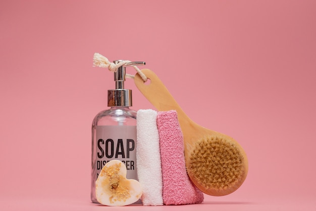 Cosmetic bottles with cosmetics for body care. acessories for bath, towel and organic dry shampoo for personal hygiene.