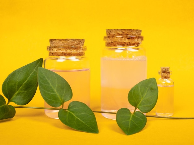 Cosmetic bottles on a yellow background.
