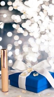 Cosmetic branding christmas glitter and girly blog concept  holiday makeup foundation base concealer...