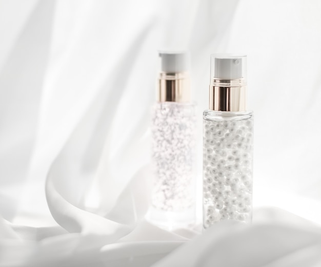 Cosmetic branding moisture and spa concept  skincare serum and makeup primer gel bottle moisturizing...