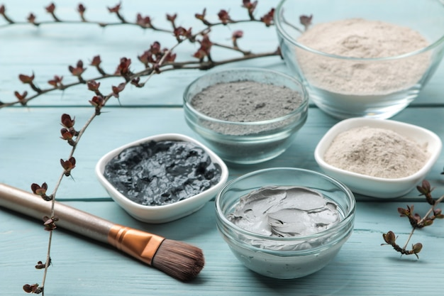 Cosmetic clay. clay facial mask on a gentle blue background. different types of clay. natural cosmetics for cosmetic procedures. beauty concept.