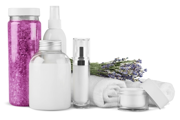 Cosmetic containers and flowers isolated on white