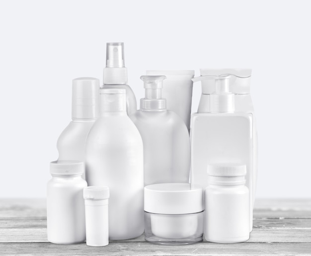Cosmetic containers isolated on background