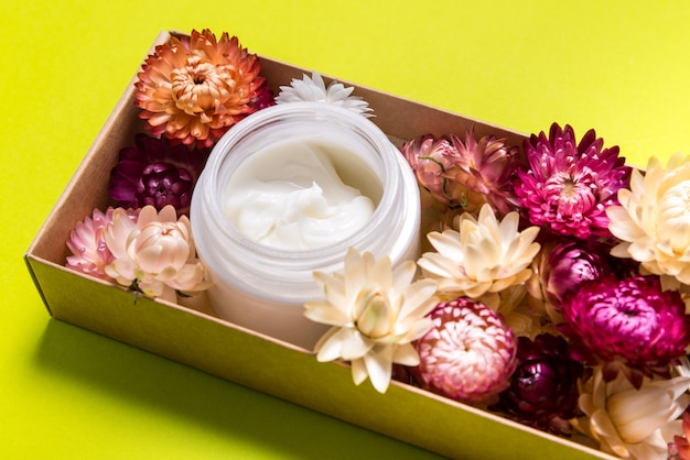 Cosmetic cream on pink table