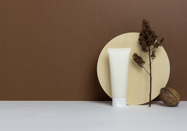 Cosmetic cream in a tube on a brown background. natural cosmetics. skincare. mock-up. copy space.