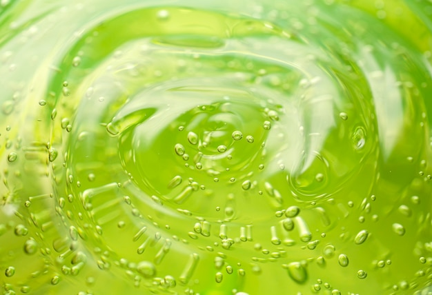 Cosmetic gel background green transparent gel with texture and bubbles close up high quality photo