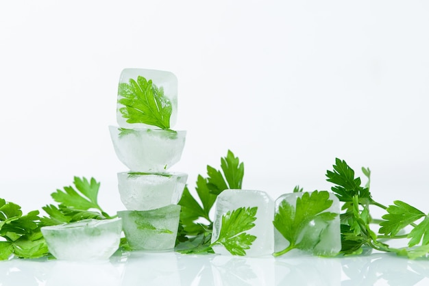 Cosmetic ice cubes with parsley for home face and body care, self-care, spa treatments, skin detox, natural organic cosmetics at home