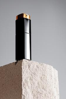 Cosmetic jar on gray cinder block close up