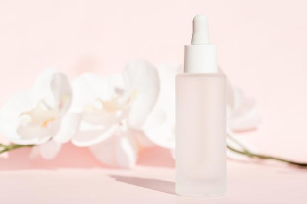 Cosmetic liquid mockup in transparent bottle