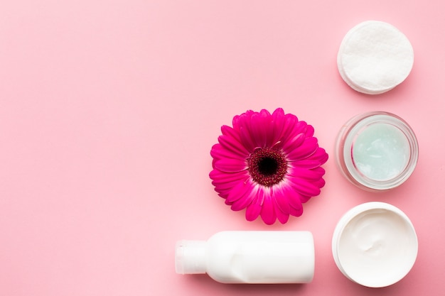 Cosmetic lotion and flower copy space