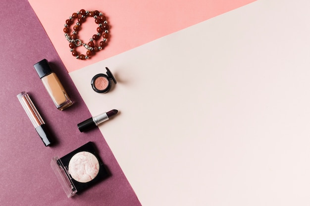 Cosmetic makeup set on multicolored surface