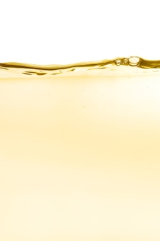 Cosmetic moisturizer skin tonic water, toner or emulsion yellow abstract texture background