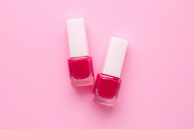 Cosmetic nail polishes pink color on pink