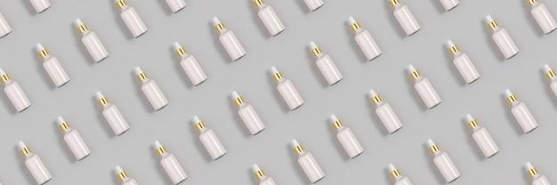Косметический узор. баннер с розовым антивозрастным коллагеном, сыворотка для лица в прозрачной стеклянной бутылке с золотой пипеткой на сером фоне. натуральный органический спа-салон косметическая концепция красоты.