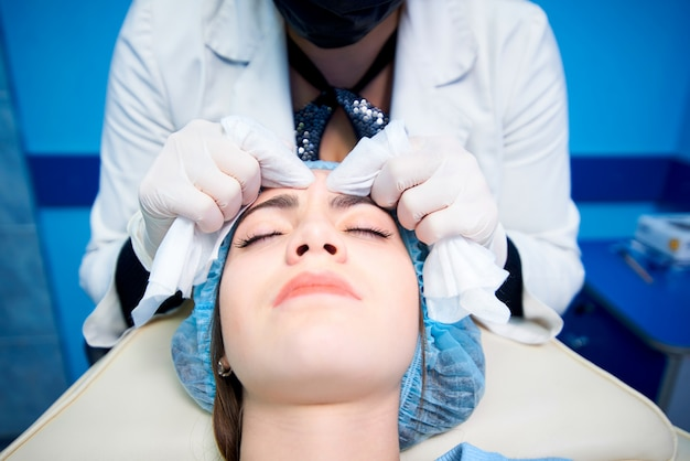 Cosmetic procedures. mechanical face cleaning. medical treatment and skin care.