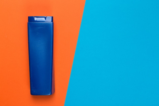 Cosmetic product on a bright bicolor surface, top view