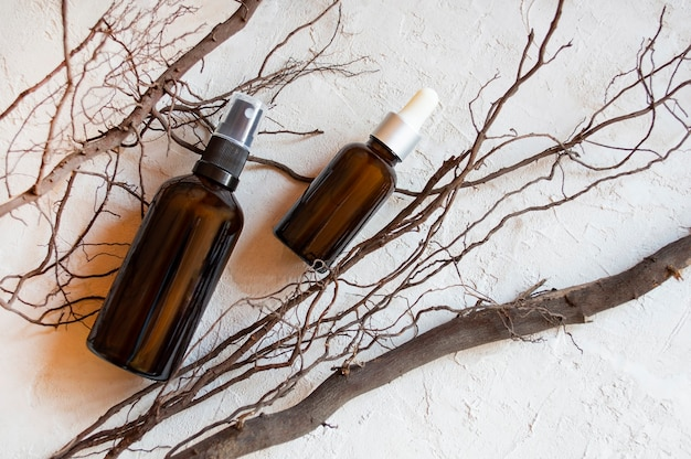 Cosmetic product poster. glass cosmetic bottle. moisturizer cream or liquid. hydrating serum