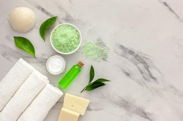 Cosmetic product with tea tree essential oil. fresh tea tree leaves, salt and oil