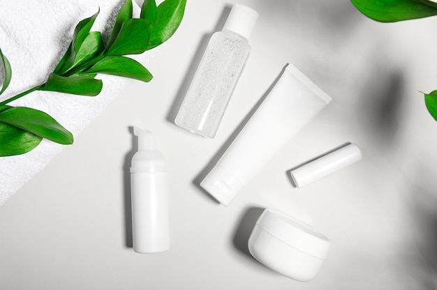Cosmetic products containers on gray light