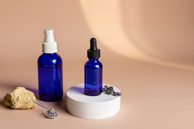 Cosmetic products in glass bottles herbal alternative medicine