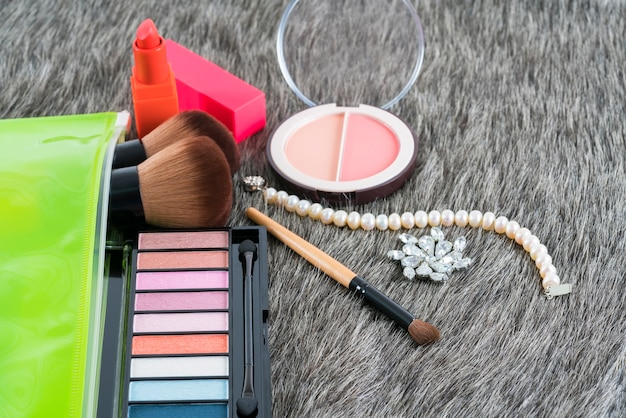 Cosmetic products  for makeup: eye shadow palette and compact blush on fake fur