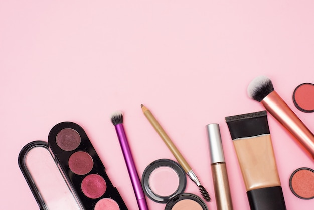 Cosmetic products on the pink background