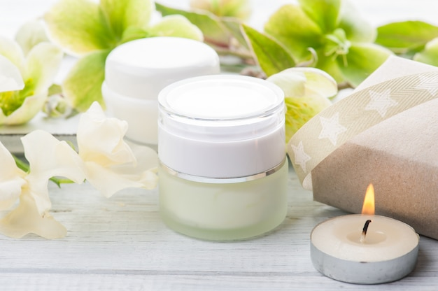 Cosmetic products on white wooden