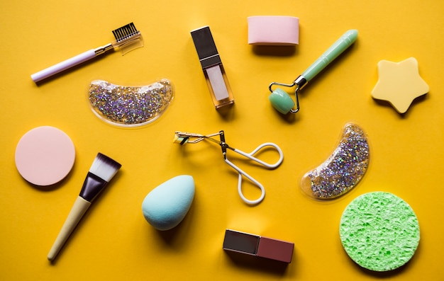Cosmetic products on yellow surface