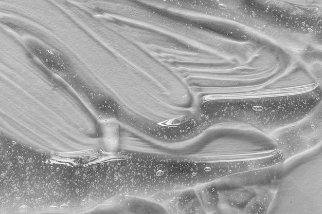 Образец косметической сыворотки или мазка-мазка с коллагеном и пептидами, косметическая эмульсия для ухода за кожей с текстурой геля.