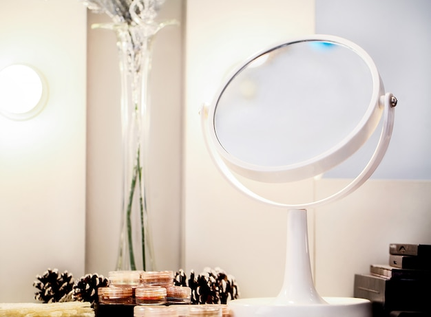 Cosmetic set on light dressing white table