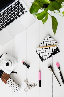 Cosmetics and camera near laptop