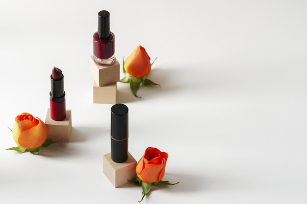 Cosmetics containers decorated with orange rose petals