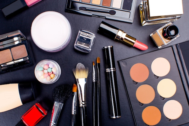Cosmetics on dark background, closeup