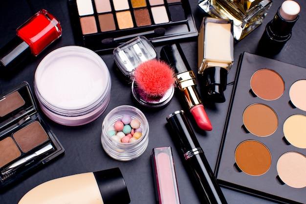 Cosmetics on dark , closeup