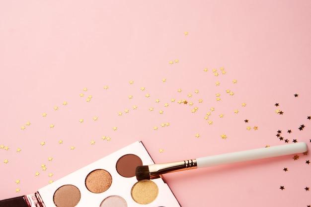 化粧品装飾アクセサリーグラマーピンクの背景上面図