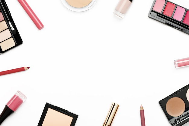 Cosmetics from above border on white background